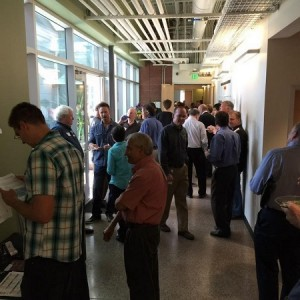 Attendees escape the heat and network in the main hallway at CEI.